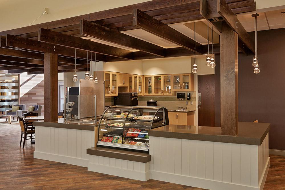 Aptura designed casual bistro area with Maxwell Thomas furniture