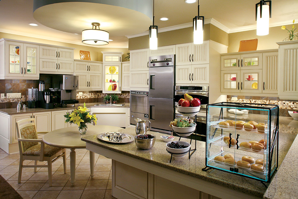 Aptura designed satellite kitchen area with Maxwell Thomas furniture
