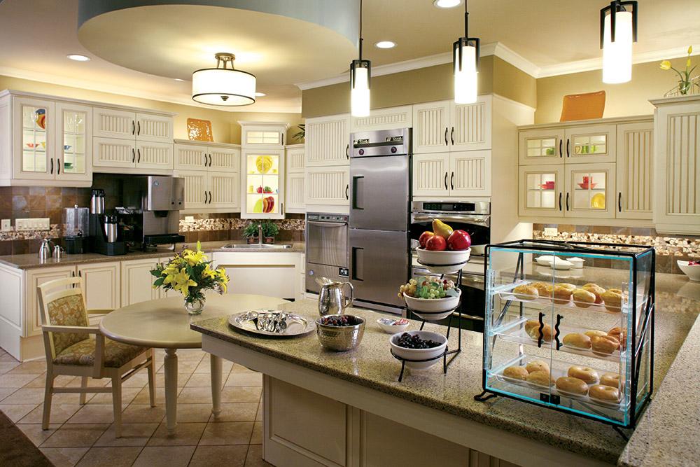 Aptura designed satellite kitchen area with Maxwell Thomas furniture