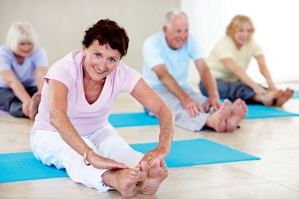 Seniors doing yoga stretching