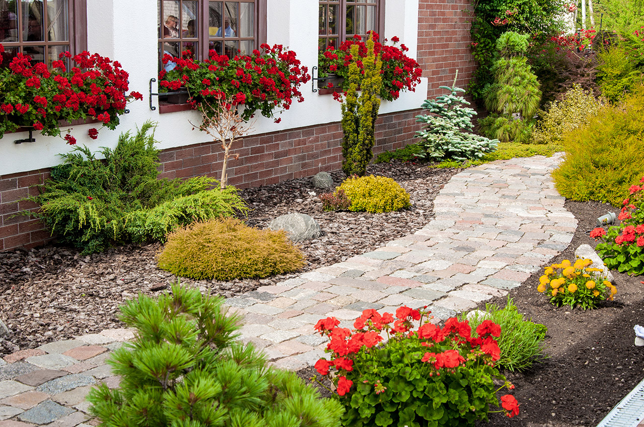 Nursing home outdoor walkway with landscaping and flowers