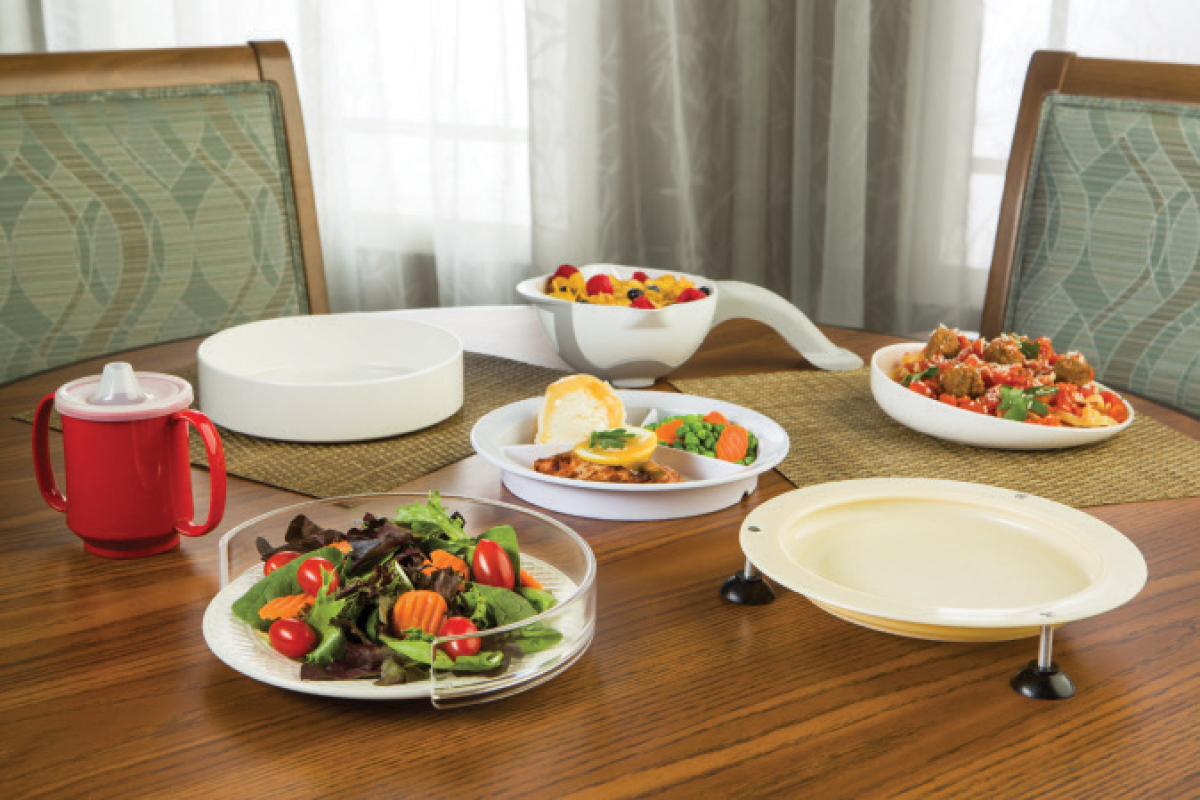 Scoop dishes, food guards and compartment plates can help seniors with hemiplegia and paralysis get their food onto utensils.