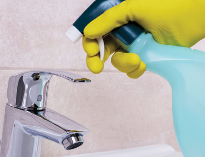 Rinsing disinfectants off surfaces using a spray bottle