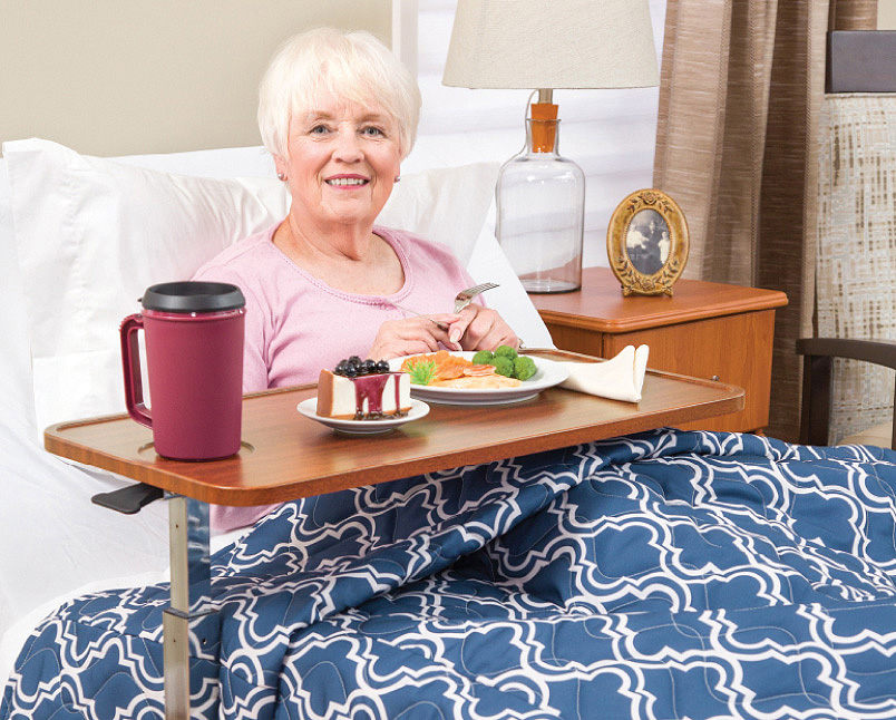 Woman in bed eating