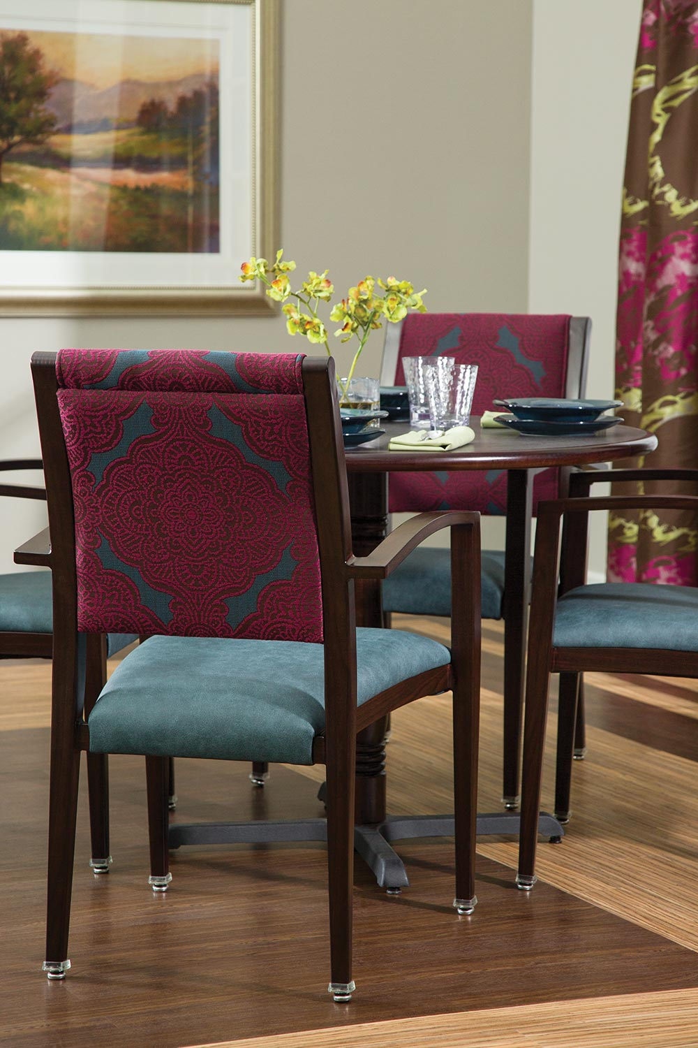 Faux-wood metal furnishings are durable and bleach-cleanable for demanding Senior Living environments.